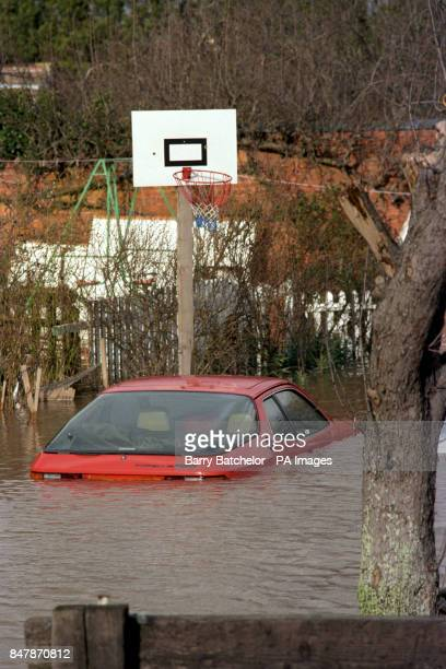 A Porsche 924 sports car is submerged by floods in the village of Maisemore Gloucestershire after 24 hours of nonstop rain swamped the surrounding...