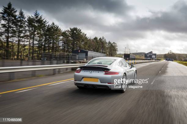 Porsche 9912 Carrera sports car driving on the Dundrod Circuit in Northern Ireland on April 17 2018