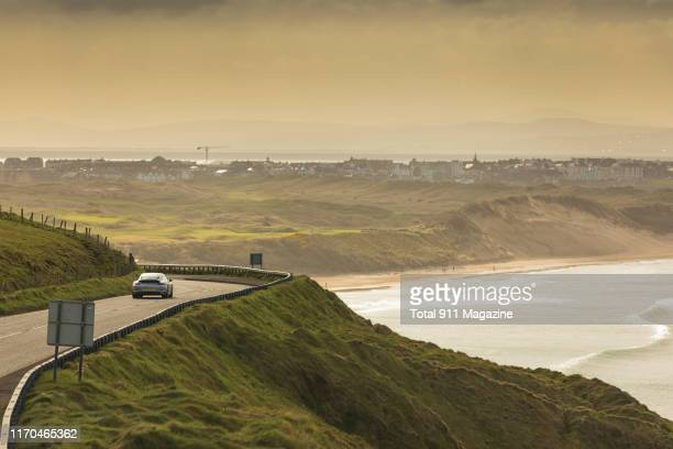 Porsche 9912 Carrera sports car photographed driving on a coastal road through County Antrim in Northern Ireland on April 17 2018