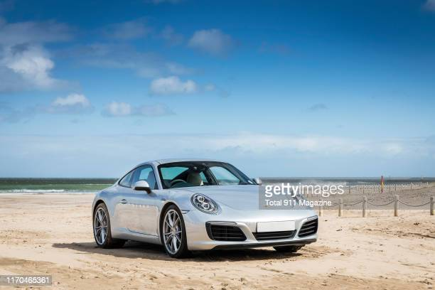Porsche 991.2 Carrera sports car photographed on a beach around County Antrim in Northern Ireland, on April 17, 2018.