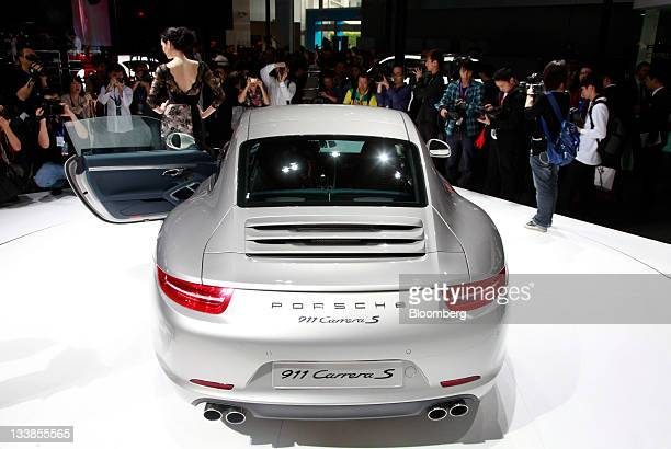 A Porsche AG 911 Carrera vehicle stands on display during the media preview of the China International Automobile Exhibition in Guangzhou Guangdong...