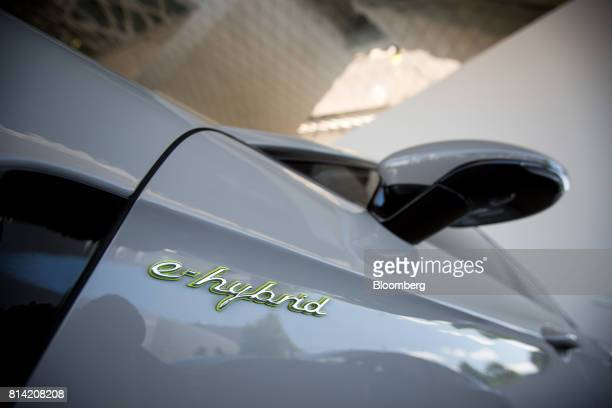 A Porsche AG Panamera 4 EHybrid luxury automobile is displayed in front of the automaker's museum in Stuttgart Germany on Thursday July 13 2017...