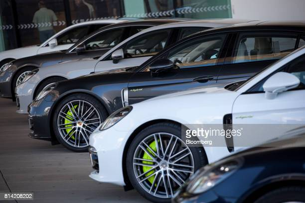 Porsche AG Panamera 4 EHybrid luxury automobiles are displayed in front of the luxury automobile maker's museum in Stuttgart Germany on Thursday July...