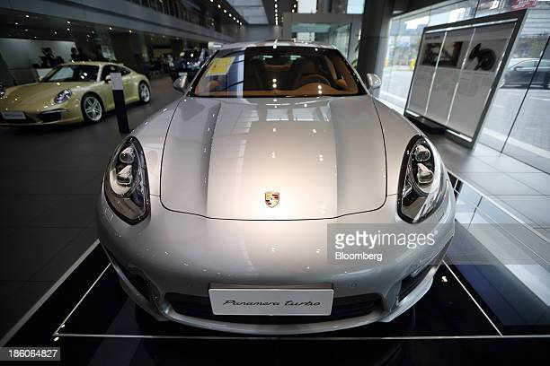 A Porsche AG Panamera Turbo sedan stands on display at the Porsche Centre Shanghai Minhang showroom in Shanghai China on Friday Oct 25 2013 China is...