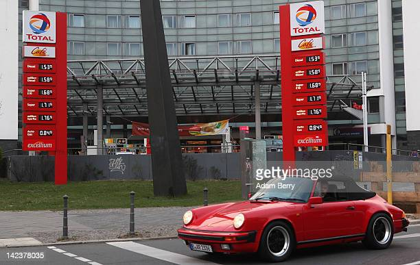 Porsche automobile passes a Total gas station on April 3 2012 in Berlin Germany The Bundesrat one of the five constitutional bodies in Germany is...