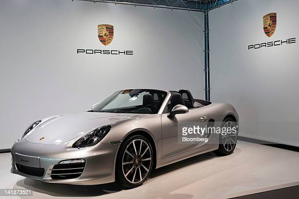 A Porsche Boxter automobile produced by Porsche Automobile Holding SE sits on display during the company's results news conference in Stuttgart...