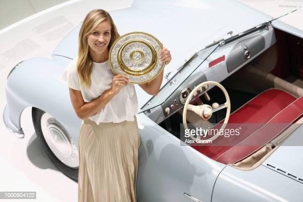 Porsche Brand Ambassador Angelique Kerber poses with the Wimbledon winner´s trophy and the Porsche 356 No 1 Roadster Show Car at the Porsche Museum...