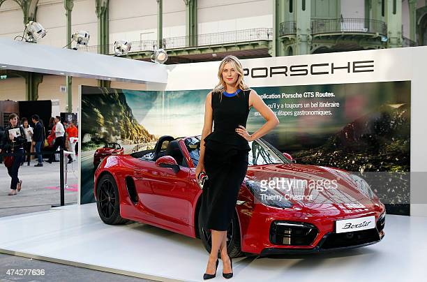 Porsche Brand Ambassador Maria Sharapova poses next to a Porsche model at the Taste of Paris event on May 21 in Paris France