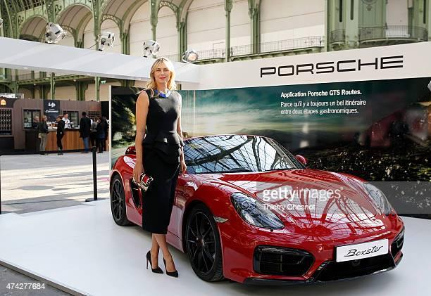 Porsche Brand Ambassador Maria Sharapova poses next to a Porsche model at the Taste of Paris event on May 21 in Paris France