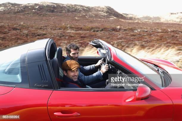 Porsche Brand Ambassador Mark Webber drives with Hollywood actor and racecar driver Patrick Dempsey a Porsche 911 Targa 4 GTS during the Grand...
