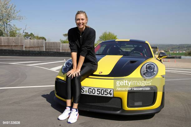 Porsche Brand Ambassadors Maria Sharapova poses after driving with Mark Webber in the high performance sports car Porsche 911 RT2 RS on the Weissach...