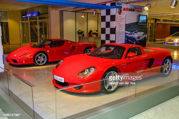 Porsche Carrera GT and Ferrari Enzo on display at Amsterdam motor show AutoRAI on February 9, 2005 in Amsterdam, The Netherlands.