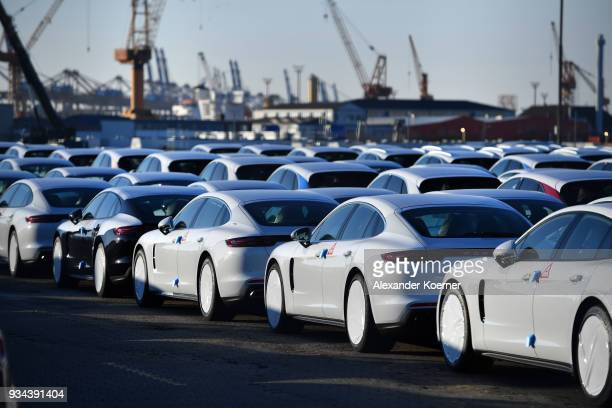 Porsche cars destined for export stand at Bremerhaven port on March 19 2018 in Bremerhaven Germany The new German government is seeking to prevent...