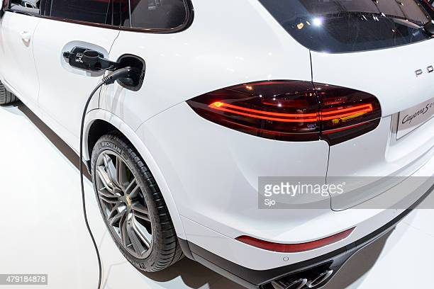 porsche cayenne s e-hybrid plug-in hybrid suv close up - porsche stock pictures, royalty-free photos & images