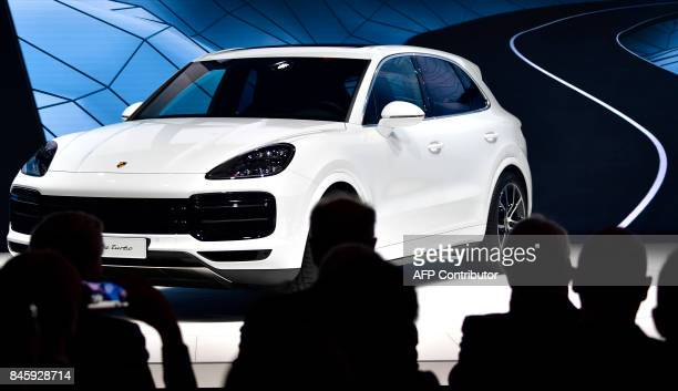 A Porsche Cayenne Turbo car is presented on stage during a show at the stand of German carmaker Porsche at the Frankfurt Motor Show IAA in Frankfurt...