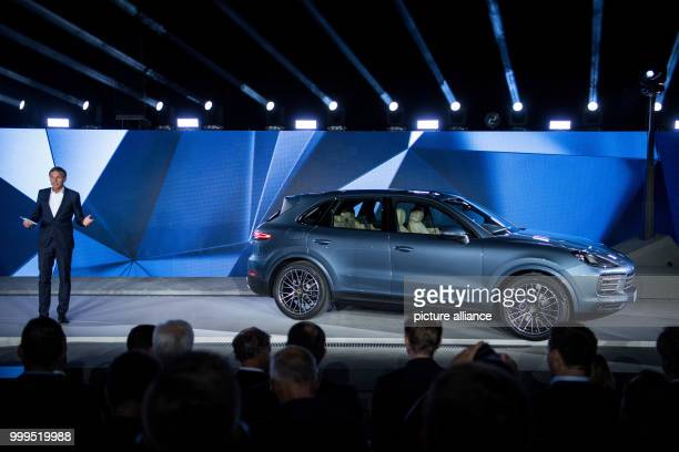 Porsche CEOOliver Blume is standing next to a new Porsche Cayenne on the stage during the presentation of the new series in Stuttgart Germany 29...
