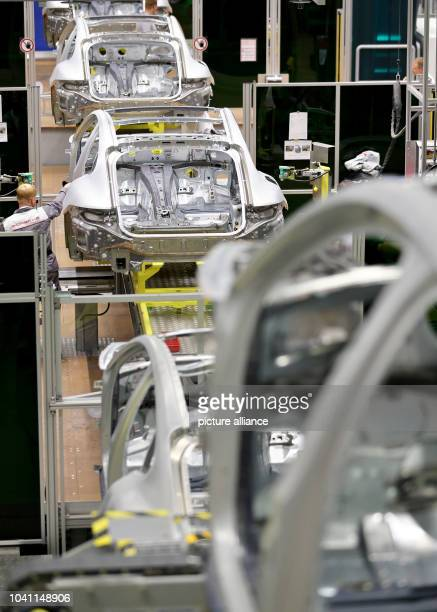 Porsche employees work on the coachwork of the Panamera model the factory in Leipzig,Germany, 02 September 2016. The car manufacturer Porsche is...