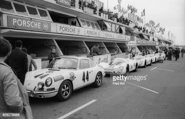 Porsche fleet lined up in front of their stalls Porsche 911 Team August Veuillet Guy Chasseuil Claude BallotLéna #44 Position 22 Le Mans 1968 24 hour...