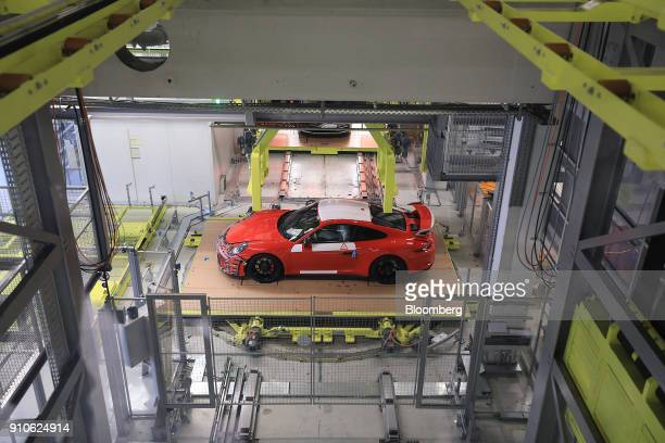 A Porsche GT 3 luxury automobile stands on the production line inside the Porsche AG factory in Stuttgart Germany on Friday Jan 26 2018 Porsche AG...