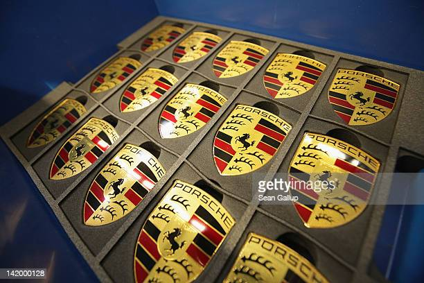 Porsche hood ornaments lie in a box on the Porsche Cayenne and Panamera assembly line at the Porsche factory on March 28 2012 in Leipzig Germany The...