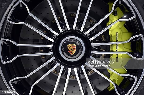 A Porsche logo is seen during the annual press conference of German carmaker Volkswagen on March 13 2014 in Berlin AFP PHOTO / JOHANNES EISELE