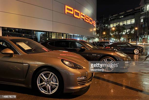 Porsche Panamera automobiles stand at a dealership outside the Porsche AG plant in Stuttgart Germany on Thursday June 21 2012 Porsche AG which is...