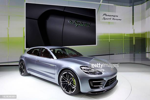 A Porsche Panemera Sport Turismo automobile produced by Porsche SE sits on display on the first day of the Paris Motor Show in Paris France on...