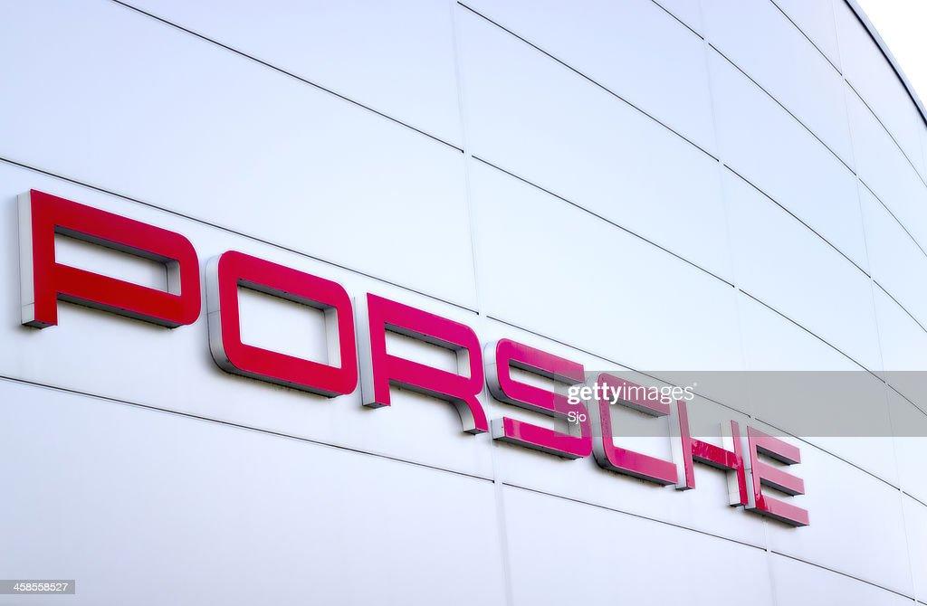 Porsche sports car manufacturer logo outside a dealership : Stock Photo