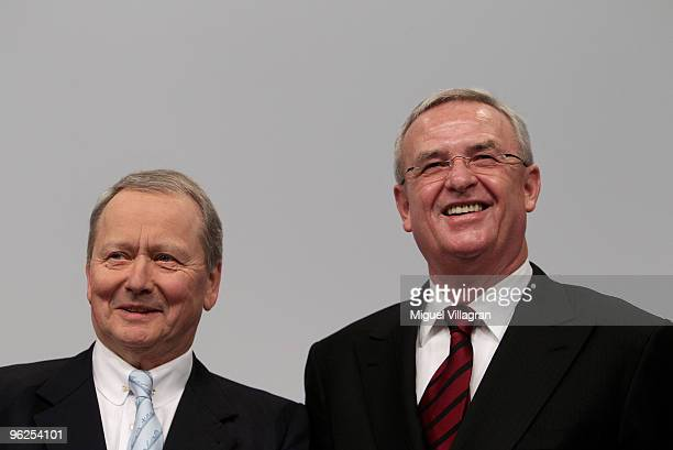 Porsche supervisory board chairman Wolfgang Porsche and Porsche CEO Martin Winterkorn look on during Porsche's annual general meeting on January 29...