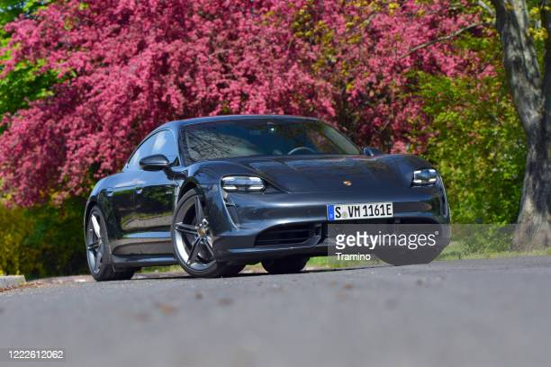 porsche taycan on a street - porsche stock pictures, royalty-free photos & images