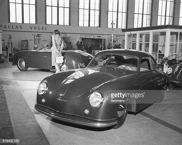 A Porsche threeseat deluxe coup and a convertible at the first postwar Berlin International Auto Show held at the Funktower Exhibition Grounds in the...