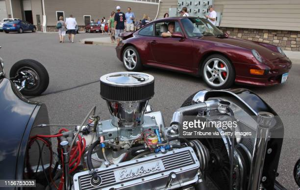 A Porsche went by a 1923 Bucket T Hotrod during the open house showcasing cars of every make and type at the AutoMotorPlex in Chanhassen August 6th...