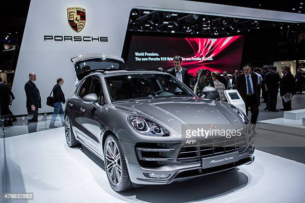 Porsche's Macan Turbo is displayed at the group's stand of the Geneva Motor Show on March 4 2014 AFP PHOTO / PIERRE ALBOUY