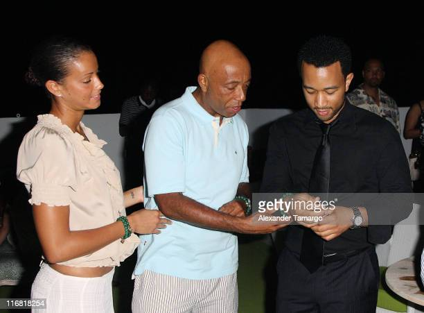 Porschla Coleman, Russell Simmons and John Legend pose at the Rush Philanthropic Arts Foundation VIP reception at the Delano Hotel on April 4, 2008...
