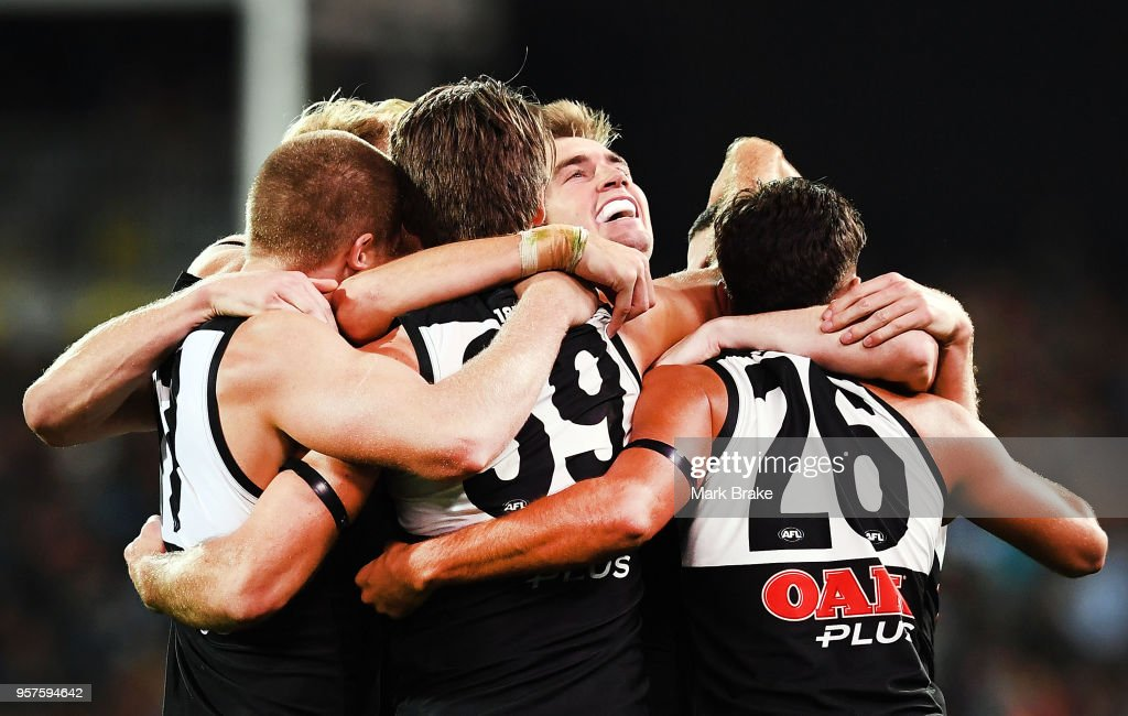 Port Adelaide celebrate after the final siren during the round eight AFL match between the Port Adelaide Power and the Adelaide Crows at Adelaide Oval on May 12, 2018 in Adelaide, Australia.