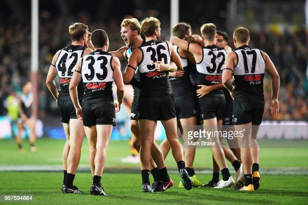 Port Adelaide celebrate after the final siren during the round eight AFL match between the Port Adelaide Power and the Adelaide Crows at Adelaide...