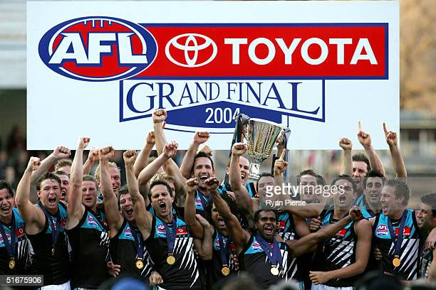 Port Adelaide celebrate with the premiership trophy after the AFL Grand Final between the Port Adelaide Power and the Brisbane Lions at the Melbourne...