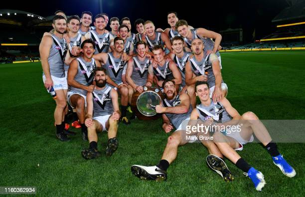Port Adelaide clelebrate with the Showdown Sheild and pose for a team photo after the round 16 AFL match between the Adelaide Crows and the Port...