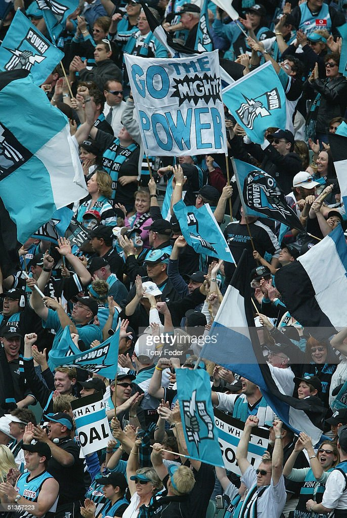 Port Adelaide fans celebrate a goal during the AFL Grand Final between the Port Adelaide Power and the Brisbane Lions at the Melbourne Cricket Ground September 25, 2004 in Melbourne, Australia.