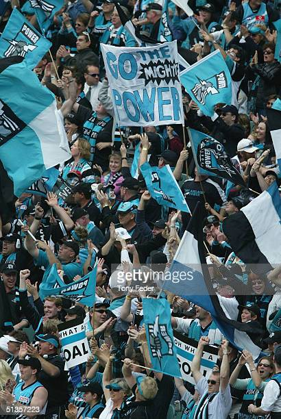 Port Adelaide fans celebrate a goal during the AFL Grand Final between the Port Adelaide Power and the Brisbane Lions at the Melbourne Cricket Ground...