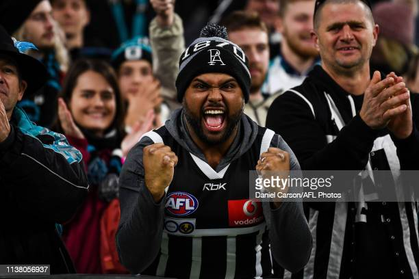 Port Adelaide fans celebrate the win during the 2019 AFL round 05 match between the West Coast Eagles and the Port Adelaide Power at Optus Stadium on...