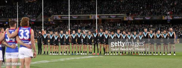 Port Adelaide players line up for the National Anthem during the 2021 AFL Second Preliminary Final match between the Port Adelaide Power and the...
