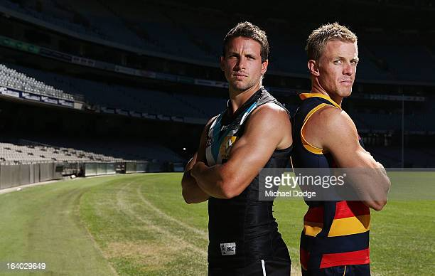 Port Adelaide Power Captain Travis Boak poses with Adelaide Captain Nathan van Berlo during the AFL Captains media Day at Etihad Stadium on March 19...