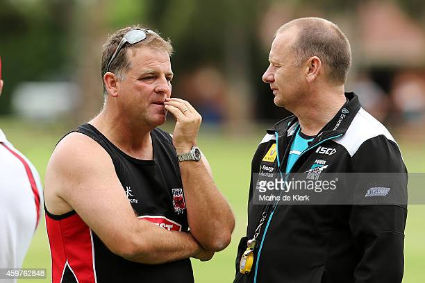 Port Adelaide Power coach Ken Hinkley speaks to Darren Berry Redbacks coach after both teams started their training in the same area during a South...
