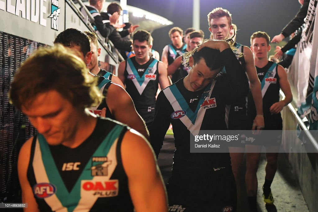 Port Adelaide Power players walk from the field after the round 21 AFL match between the Port Adelaide Power and the West Coast Eagles at Adelaide Oval on August 11, 2018 in Adelaide, Australia.
