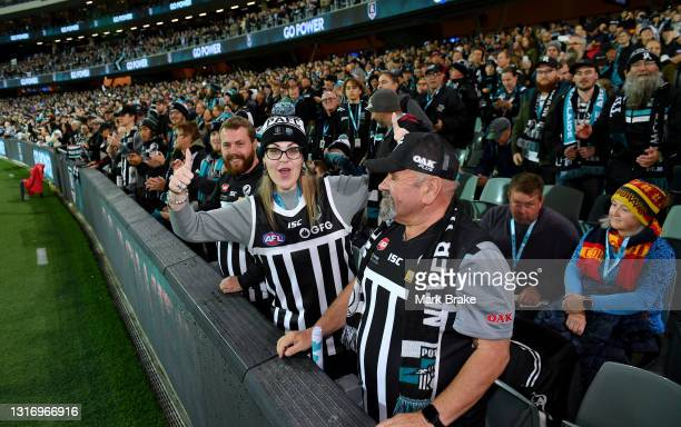 Port Adelaide Power supporters before start of the round eight AFL match between the Port Adelaide Power and the Adelaide Crows at Adelaide Oval on...
