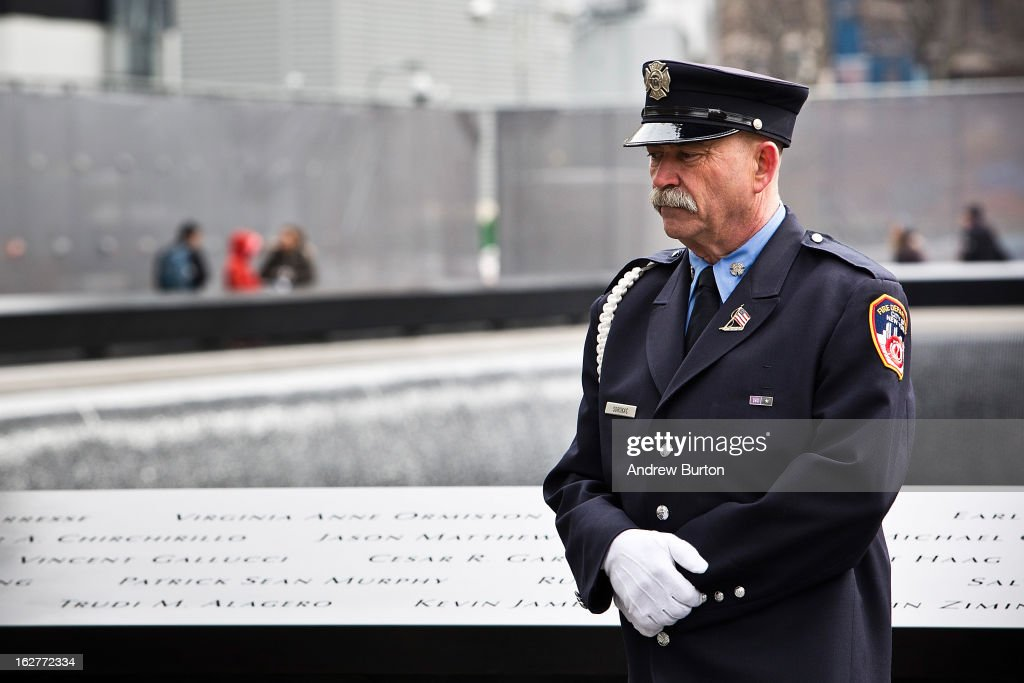 A port authority officer stands before the 20th Anniversary Ceremony for the 1993 World Trade Center bombing at Ground Zero on February 26, 2013 in New York City. The attack, which utilized a car bomb and hit the north tower, killed six people.