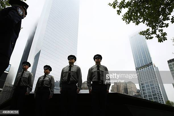 Port Authority police cadets pause at the Ground Zero memorial site during the dedication ceremony of the National September 11 Memorial Museum in...