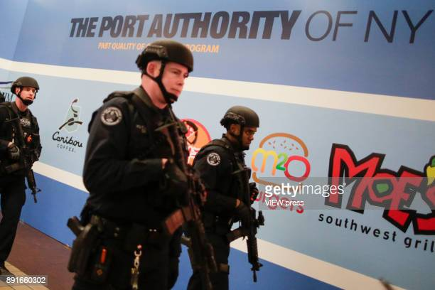 Port Authority Police Counter Terrorism Unit patrols inside the New York Port Authority Bus Terminal December 11 2017 in New York City The Police...