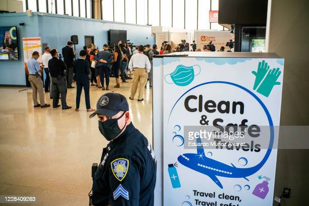 Port Authority police officer stands watch on the day the new COVID-19 testing facility XpresCheck became available for passengers at Newark Liberty...